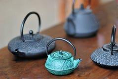 Cast iron teapots stock photography