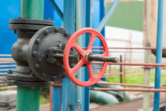 Cast iron valve on the water line. Royalty Free Stock Images