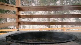 The cast iron vat with mineral water and turned off the tap with cold water. The cast iron vat with mineral water and turned off the tap with cold water stock footage