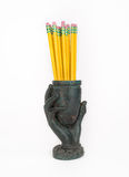 Cast Metal Hand Vase with Pencils. Royalty Free Stock Images