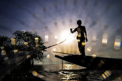 Cast a net. Fisherman casting his net at sunrise royalty free stock photography