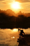 Cast net fisherman silhouette. Stock Photo