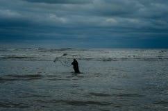 Cast net fishing on Black Sea Stock Photos