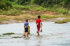 Cast a net. SAVANNAKHET,LAOS-OCTOBER 6 : The boy ready to cast a net in the river at Savannakhet,Laos on October 6,2014.Cast a net is popular way to catch fish stock photography