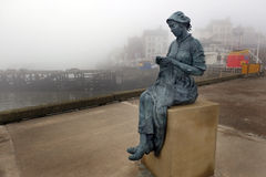 Cast statue of fisherwoman in Bridlington. Royalty Free Stock Image