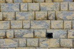 Stone wall grunge background abstract with Pipe royalty free stock image