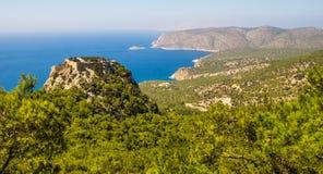 Casta di Monolithos, isola di Rodi, Grecia - paesaggio del seaview Immagine Stock