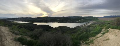 Castaic Lake. Panoramic photo of Castaic Lake shot in the setting sun Royalty Free Stock Photo