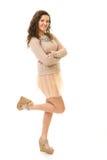 Castana riccio in Mini Skirt rosa Fotografia Stock Libera da Diritti