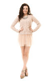 Castana riccio in Mini Skirt rosa Immagine Stock