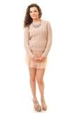 Castana riccio in Mini Skirt rosa Immagini Stock Libere da Diritti