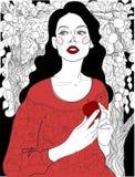 Castana in un vestito rosso in un giardino fotografia stock libera da diritti