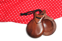Castanets and flamenco dress Stock Images