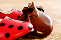 Castanets and typical dot-patterned flamenco shoes Stock Photos