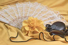Castanets, yellow rose and white fan lying closeup Royalty Free Stock Photography