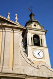 Castano primo      wall  and church tower bell sunny day Stock Photos