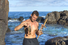 Castaway fishing with primitive tool Stock Photography