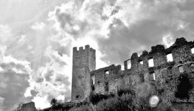 Castle ancient BW. Castel Belfort, though partially in ruins, is still an imposing and eye-catching building. It features an old embattled tower surrounded by Royalty Free Stock Images