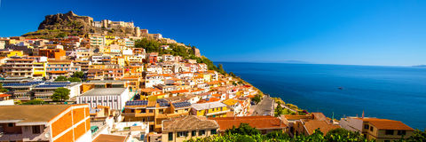 Castel and colorful houses in Castelsardo town, Sardinia, Italy. Castel and colorful houses in Castelsardo town, Sardinia, Italy Royalty Free Stock Photography