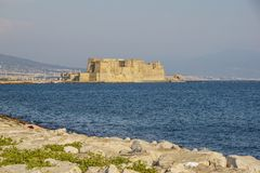 Castel dell`Ovo italian for the Egg fortress in the harbor of Naples in Italy, with the Gulf of Naples Royalty Free Stock Image