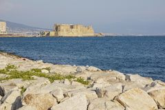 Castel dell`Ovo italian for the Egg fortress in the harbor of Naples in Italy, with the Gulf of Naples Stock Photo