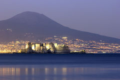 Castel dell'Ovo with Mount Vesuvius in the background in Naples Stock Photo