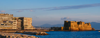 Castel dell Ovo at sunset in the bay of Naples italy Stock Photography