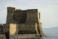 Castel in Naples. Castel dell'Ovo, or Egg Castle middle aged fortress in the Bay of Naples royalty free stock photography