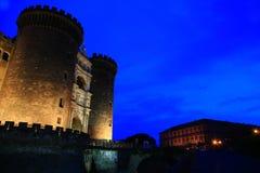 Castel Nuovo au crépuscule Photo stock