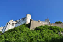 Castel on a rock. An old Austrian white castle on a rock, view from below Stock Photos