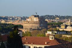 Castel San Angelo. (Castle of the Saint Angel) from Trastevere, Rome, looms above the skyline. Photo taken April 2015 Royalty Free Stock Photography