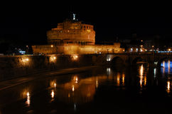 Castel San'Angelo by night. Romantic view from a bridge over Tiber river Stock Photography