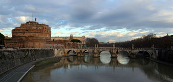 Castel San Angelo, panoramic. Shot in Rome, Italy. A beautiful old castle found in the riverside of Tiber, in the old city of Rome. This is a photo stitch of 2 Stock Photos