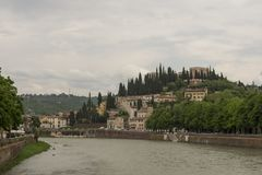 Castel San Pietro against a cloudy sky with Adige river in forefront. Picture from Verona Italy stock image
