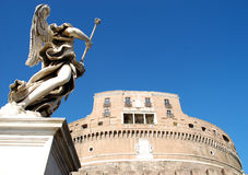 Castel Sant Angelo and angel. Castel Sant'Angelo, with a brilliant blue sky and a defending angel. Rome, Italy royalty free stock image