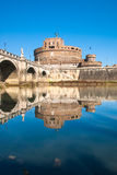 Castel Sant'Angelo and reflection on water. The world famous monument Castel Sant'Angelo in Rome, Italy, with its bridge upon the tevere river and its reflection Stock Photos