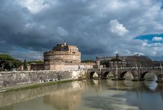 Castel Sant Angelo at River Tiber in Rome in Italy. At rainy weather royalty free stock photos