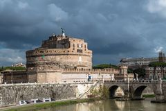 Castel Sant Angelo at River Tiber in Rome in Italy. At rainy weather royalty free stock photo