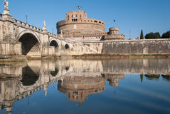 Castel Sant'Angelo, Rome, Italy and reflection on water. The world famous monument Castel Sant'Angelo in Rome, Italy, with its bridge upon the tevere river and Royalty Free Stock Photo