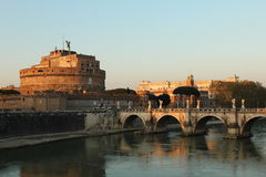 Castel Sant'Angelo at sunset. The unique castel Sant'Angelo viewed from opposite river bank at sunset. The colors give it a nice dreamy glow Stock Photography