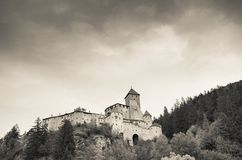 Castel Taufer in Ahrntal is an old mountain castle in misty environment stock photo