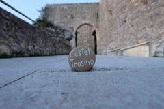 Castel Trosino, souvenir with a carved stone. Souvenir of Castel Trosino, old medieval village, Ascoli Piceno county, Marche region, Italy Royalty Free Stock Photos