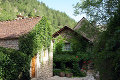 Castelbouc Village. Scenic view of ivy covered stone houses in Castelbouc village, Sainte-Enimie commune, Lozere, France Royalty Free Stock Photos