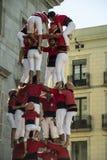 Castelers que escala a formação do castelo no La Merce Foto de Stock Royalty Free