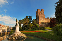 Castelfranco Veneto - Treviso Italy. Old walls of Castelfranco Veneto and Giorgione statue, northeast side (XII-XIII century) in the province of Treviso, north Royalty Free Stock Image