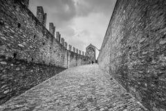 Castelgrande castle in Bellinzona, Switzerland. Bellinzona, Switzerland - May 28, 2016: People walking on the walls of Castelgrande castle at Bellinzona on the Royalty Free Stock Photography