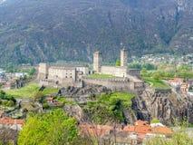 Castelgrande from other castle. Castelgrande and surrounding cityscpae view from Castello di Montebello in Bellinzona, Switzerland Royalty Free Stock Image