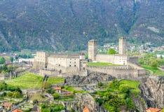 Castelgrande from other castle. Castelgrande and surrounding cityscpae view from Castello di Montebello in Bellinzona, Switzerland Stock Images