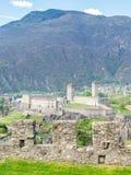 Castelgrande from other castle. Castelgrande and surrounding cityscpae view from Castello di Montebello in Bellinzona, Switzerland Stock Image