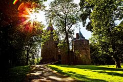 Castell Coch, Red Castle, Tongwynlais, South Wales. United Kingdom. Sunset over green lawn Stock Photography
